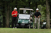 Former United States President Bill Clinton (L) and U.S. President Barack Obama (R) chat after completing the first hole during a golf game at Joint Base Andrews, Maryland, September 24, 2011. .Credit: Chris Kleponis / Pool via CNP