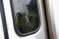 Greenbelt, MD - January 6, 2014:  The Metro logo is visible through the window of a new 7000-series rail car as it arrived at the Greenbelt Metro station. The new cars will enter service after extensive testing.  (Photo by Don Baxter/Media Images International)