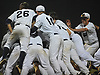 Massapequa teammates celebrate after their 4-0 win over Plainview JFK in Game 3 of the Nassau County varsity baseball Class AA final at SUNY Old Westbury on Tuesday, May 30, 2017.