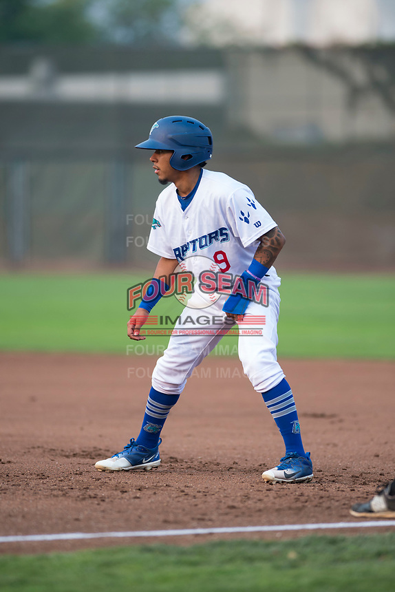 Ogden Raptors second baseman Kenneth Betancourt (9) takes a lead off first base during a Pioneer League game against the Great Falls Voyagers at Lindquist Field on August 23, 2018 in Ogden, Utah. The Ogden Raptors defeated the Great Falls Voyagers by a score of 8-7. (Zachary Lucy/Four Seam Images)