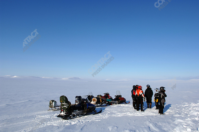 A group of adventure tourists stopped in the tundra of northern Chukotka on their way to the northern shoreline of the Chukotka Sea. Chukotka Autonomous Okrug, Russia, April 9, 2007.