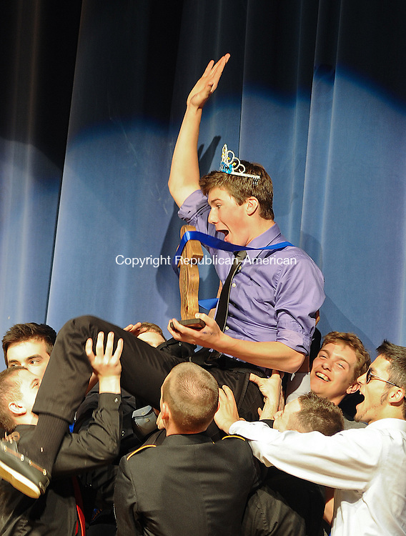WINSTED, CT-19 APRIL 2012--041912JS03-Brock Fleiger, a senior at The Gilbet School in Winsted, is hoisted up by other contestants after being crowned Mr. TGS during a pagent Thursday at the school. The event was a held as a fundraiser for the National Honor Society. . Jim Shannon Republican-American