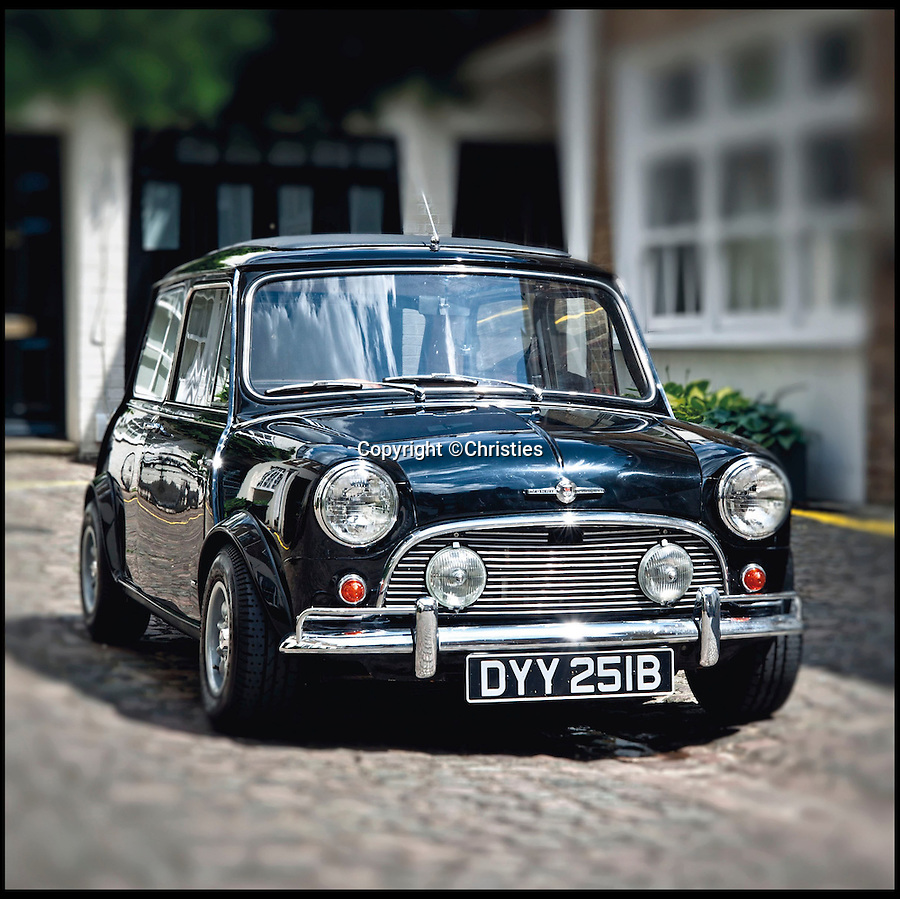 BNPS.co.uk (01202 558833)<br /> Pic: Christies/BNPS<br /> <br /> **Please use full byline**<br /> <br /> A front view of the well-presented, rare Radford Mini De Ville.<br /> <br /> The Rolls Royce... of Mini.<br /> <br /> <br /> An incredibly rare 50-year-old Mini car that was the most luxurious ever made has gone on the market with a whopping 50,000 pounds price tag.<br /> <br /> The pint-sized motor was fitted out with so many deluxe features when it was made in 1964 that it has been described as a Rolls Royce in a Mini's body.<br /> <br /> It boasts a host of innovations and indulgences more common in lavish cars like Rolls Royces and Aston Martins.<br /> <br /> These include electric windows, wooden trim, leather seats, full length sun-roof and deep-pile carpets made from lamb's wool.<br /> <br /> This particular Mini was lovingly restored in the 1990s for Beatles guitarist George Harrison but he passed away from cancer before the work was completed.<br /> <br /> It is tipped to fetch 50,000 pounds when it goes under the hammer at London auction house Christie's on September 3.