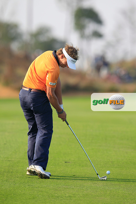 Joost Luiten (NED) plays his 2nd shot on the 16th hole during Sunday's Final Round of the 2014 BMW Masters held at Lake Malaren, Shanghai, China. 2nd November 2014.<br /> Picture: Eoin Clarke www.golffile.ie