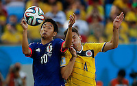 CUIABA -  BRASIL -24-06-2014.  Foto: Roberto Candia / Archivolatino<br /> Santiago Arias (#4) jugador de Colombia (COL) disputa el balón con Shinji Kagawa (#10) jugador de Japón (JPN) durante partido del Grupo C de la Copa Mundial de la FIFA Brasil 2014 jugado en el estadio Arena Pantanal de Cuiaba./ Santiago Arias (#4) player of Colombia (COL) fights the ball with Shinji Kagawa (#10) player of Japan (JPN) during the match of the Group C of the 2014 FIFA World Cup Brazil played at Arena Pantanal stadium in Cuiaba. Photo: Roberto Candia / Archivo Latino<br /> VizzorImage PROVIDES THE ACCESS TO THIS PHOTOGRAPH ONLY AS A PRESS AND EDITORIAL SERVICE IN COLOMBIA AND NOT IS THE OWNER OF COPYRIGHT; ANOTHER USE IS REPONSABILITY OF THE END USER. NO SALES, NO MERCHANDASING. ALL COPYRIGHT IS ARCHIVOLATINO