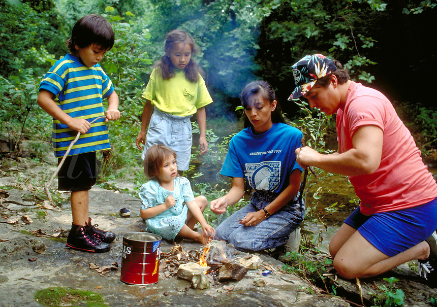 Cherokee family cooking crawdads they have caught in a creek, Tahlequah, OK