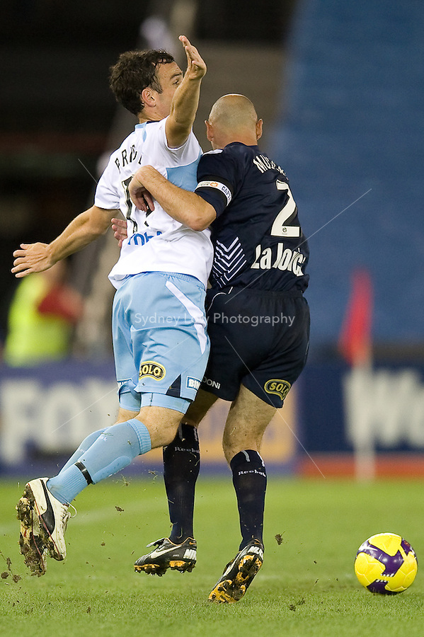 MELBOURNE, AUSTRALIA - MARCH 20, 2010: Mark Bridge from Sydney FC and Kevin Muscat of Melbourne Victory fight for the ball in the final of the 2010 A-League between the Melbourne Victory and Sydney FC at Etihad Stadium on March 20, 2010 in Melbourne, Australia. Photo Sydney Low www.syd-low.com