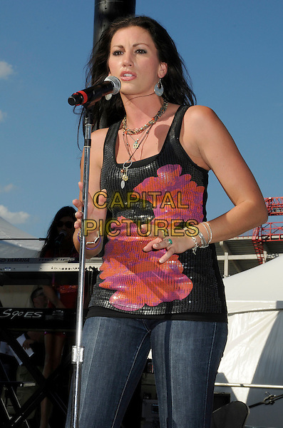 DANIELLE PECK.2008 CMA Music Festival Greased Lightning Riverfront Daytime Stage, Nashville, Tennessee, USA, .05 June 2008..country music microphone concert gig on stage half length jeans black pink sequined top.CAP/ADM/LF.©Laura Farr/Admedia/Capital PIctures