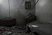 The room where two children used to sleep is now empty after a mortar shell tore through the roof of a civilian home in the Salahadeen neighborhood of Aleppo.<br /> September, 2012.