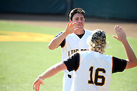 Lucas Tancas (19) of the Long Beach State Dirtbags is greeted by teammate Darren McCaughan (16) after scoring a run during a game against the Arizona State Sun Devils at Blair Field on February 27, 2016 in Long Beach, California. Long Beach State defeated Arizona State, 5-2. (Larry Goren/Four Seam Images)