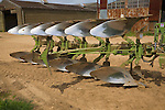 Close up of steel blades of modern plough