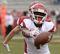 NWA Democrat-Gazette/ANDY SHUPE<br /> Arkansas receiver De'Vion Warren reaches to make a catch Saturday, April 6, 2019, as defensive back Nathan Parodi defends during the Razorbacks' spring game in Razorback Stadium in Fayetteville. Visit nwadg.com/photos to see more photographs from the game.