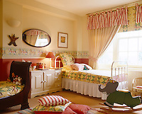A children's bedroom incorporates two different styles of bed and a grown-up style of decoration