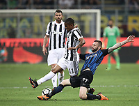 Calcio, Serie A: Inter - Juventus, Milano, stadio Giuseppe Meazza (San Siro), 28 aprile 2018.<br /> Juventus' Douglas Costa (l) in action with Marcelo Brozovic (r) during the Italian Serie A football match between Inter Milan and Juventus at Giuseppe Meazza (San Siro) stadium, April 28, 2018.<br /> UPDATE IMAGES PRESS/Isabella Bonotto