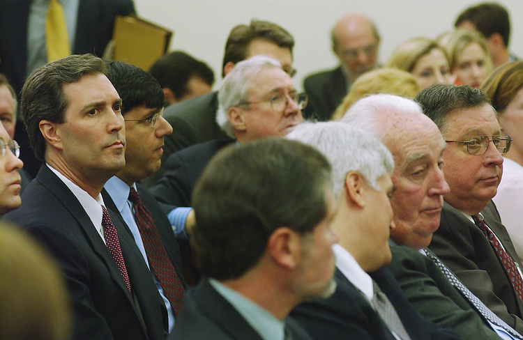 01/24/02.ENRON HEARING--David Duncan, former Andersen partner-in-charge of Enron engagement, far left, flanked by his lawyers, waits for start of the House Energy and Commerce Subcommittee on Oversight and Investigations hearing on the destruction of Enron-relatedÊdocuments by Andersen personnel. He was called as a witness, but refused to answer questions, invoking the Fifth Amendment..CONGRESSIONAL QUARTERLY PHOTO BY SCOTT J. FERRELL