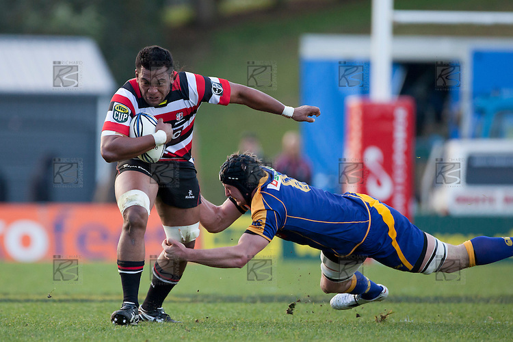 Viliami Fihaki gets tackled around one leg by Paul Grant. ITM Cup Round 1 game between the Counties Manukau Steelers and Otago, played at Bayer Growers Stadium, Pukekohe, on Saturday July 31st 2010. Counties Manukau Steelers won 29 - 13 after leading 22 - 6 at halftime.