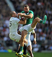 Mike Brown of England competes with Dave Kearney of Ireland for the ball in the air. QBE International match between England and Ireland on September 5, 2015 at Twickenham Stadium in London, England. Photo by: Patrick Khachfe / Onside Images