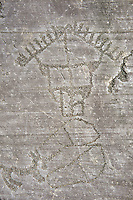 Prehistoric Petroglyph, rock carving, of a hut raied on wooden ploes carved by the Camunni people in the ,iddle to late iron age between  900-1200 BC,  Seradina-Bedolina Archaeological Park, Valle Comenica, Lombardy, Italy