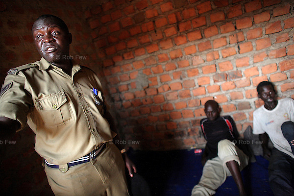 As well as training officers, OHCHR staff monitor camp conditions, treatment of prisoners and observance of due process. Here the Officer in Charge of the Police Post escorts OHCHR staff to interview three men recently arrested in the camp.<br />