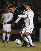 John Stertzer #27 of the University of Maryland clashes with Drew Cost #8 of Penn State during an NCAA 3rd. round match at Ludwig Field, University of Maryland, College Park, Maryland on November 28 2010.Maryland won 1-0.
