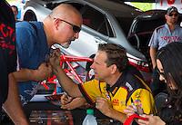 Jun 5, 2015; Englishtown, NJ, USA; NHRA funny car driver Del Worsham signs autographs during qualifying for the Summernationals at Old Bridge Township Raceway Park. Mandatory Credit: Mark J. Rebilas-