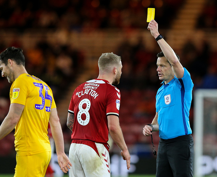 Referee Darren England shows Middlesbrough's Adam Clayton a yellow card<br /> <br /> Photographer Alex Dodd/CameraSport<br /> <br /> The EFL Sky Bet Championship - Middlesbrough v Preston North End - Tuesday 1st October 2019  - Riverside Stadium - Middlesbrough<br /> <br /> World Copyright © 2019 CameraSport. All rights reserved. 43 Linden Ave. Countesthorpe. Leicester. England. LE8 5PG - Tel: +44 (0) 116 277 4147 - admin@camerasport.com - www.camerasport.com
