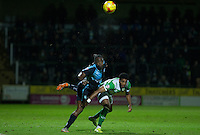 Anthony Stewart of Wycombe Wanderers beats Shaun Jeffers of Yeovil Town in the air during the Sky Bet League 2 match between Yeovil Town and Wycombe Wanderers at Huish Park, Yeovil, England on 24 November 2015. Photo by Andy Rowland.