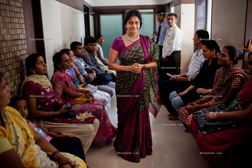 Dr. Nayna H. Patel poses for a portrait in the Akanksha Infertility Clinic in the small town of Anand, Gujarat, India. The Akanksha Infertility Clinic is known internationally for its surrogacy program and currently has over a hundred surrogate mothers pregnant in their environmentally controlled surrogate houses. <br /> Photo by Suzanne Lee for Panos London