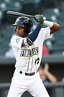 Hansel Moreno (12) of the Columbia Fireflies bats during a game against the Charleston RiverDogs on Tuesday, August 28, 2018, at Spirit Communications Park in Columbia, South Carolina. (Tom Priddy/Four Seam Images)