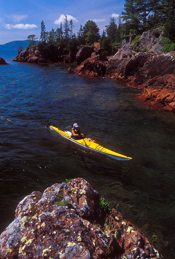 A sea kayaker explores the rugged Lake Superior shoreline of the Keweenaw Peninsula near Lac LaBelle, Mich.