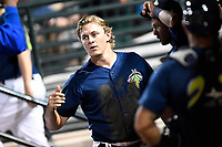 Third baseman Reed Gamache (40) of the Columbia Fireflies is congratulated after scoring a run in a game against the Lexington Legends on Thursday, June 8, 2017, at Spirit Communications Park in Columbia, South Carolina. Columbia won, 8-0. (Tom Priddy/Four Seam Images)