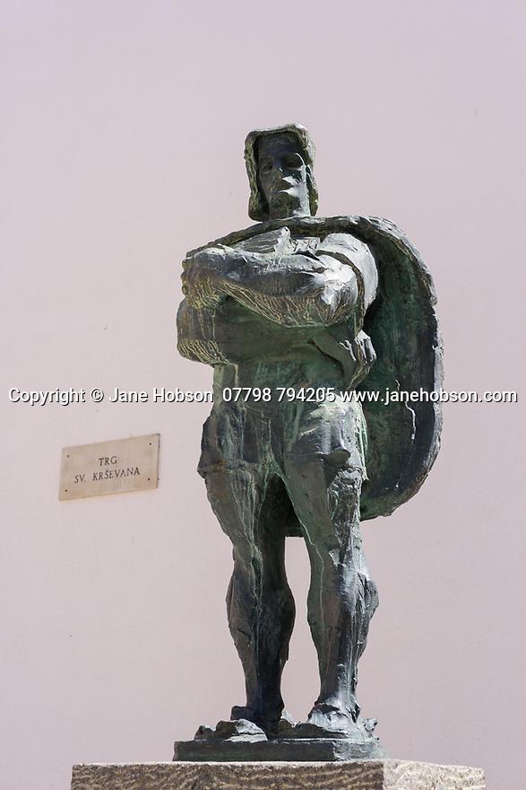 Male statue on the Trg SV Krsevana, Zadar, Croatia.