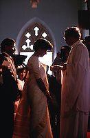 The silhouette of a bride and priest at a wedding at an Indian Marthomite Christian church. Kerala, India.