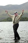 JACKIE HEALY-RAE KILLARNEY 6-9-01<br />South Kerry TD Jackie Healy-Rae  shows he can walk on water at Lough Lein Killarney.<br />Picture by Don MacMonagle