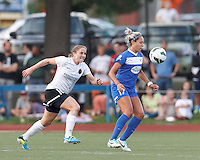 Boston Breakers forward Kyah Simon (17) controls the ball as Portland Thorns FC defender Rachel Buehler (16) closes. In a National Women's Soccer League (NWSL) match, Boston Breakers (blue) defeated Portland Thorns FC (white/black), 2-1, at Dilboy Stadium on August 7, 2013.