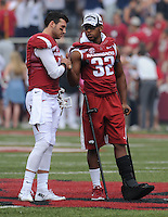 NWA Democrat-Gazette/ANDY SHUPE<br /> Arkansas' Brandon Allen (left) shakes the hand of injured Jonathan Williams before the coin flip Saturday, Sept. 5, 2015, during the first quarter of play in Razorback Stadium in Fayetteville. Visit nwadg.com/photos to see more from the game.