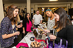 TORRINGTON, CT. 12 January 2020-011220BS10 - New bride to be in 2021 Sarah Palladino right, with her friend next to her Jalysa Smith both of Thomaston looks at a menu of cupcakes and other treats given to them by Erica Figueiral of New Hartford, left, at the Wedding Cakes Unlimited display table, during the annual Bridal Show at the Carole and Ray Neag Performing Arts Center inside the Warner Theatre in Torrington on Sunday. Bill Shettle Republican-American