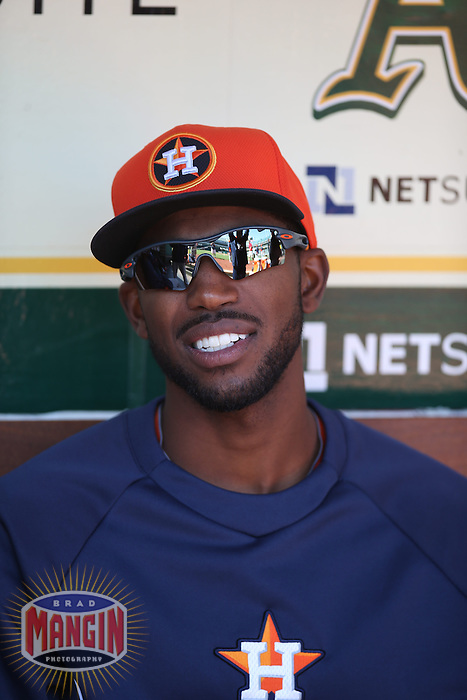 OAKLAND, CA - APRIL 19:  Dexter Fowler #21 of the Houston Astros sits in the dugout before the game against the Oakland Athletics at O.co Coliseum on Saturday, April 19, 2014 in Oakland, California. Photo by Brad Mangin
