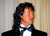 American actor, director, screenwriter, and producer Sylvester Stallone  makes remarks after accepting the President's Council on Physical Fitness award at the Washington, DC Touchdown Club dinner in Washington, DC on January 23, 1988.  <br /> Credit: Arnie Sachs / CNP