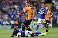 Youri Tielemans of Leicester City is brought down by Matt Doherty of Wolverhampton Wanderers during Leicester City vs Wolverhampton Wanderers, Premier League Football at the King Power Stadium on 11th August 2019