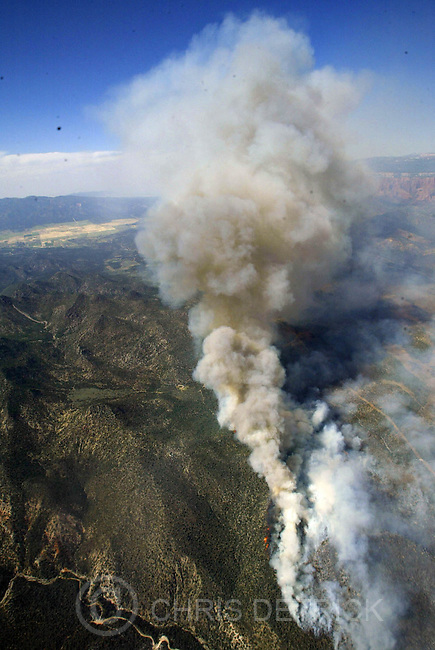 Toquerville,Utah--6/26/2005- .**This is the view from the Channel 2 Helicopter.**.The Blue Springs fire continues to burn to the North, West and South of I-15.  Over 8,000 acres have burned so far in the blaze that started around 3pm Saturday afternoon. .** Pictures from the West Side Complex Fire..Photo By: Chris Detrick /Salt Lake Tribune.File #816G5288
