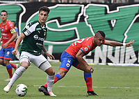 PALMIRA - COLOMBIA, 01-09-2019: Juan Ignacio Dinenno del Cali disputa el balón con Cesar Amaya de Pasto durante partido entre Deportivo Cali y Deportivo Pasto por la fecha 9 de la Liga Águila II 2019 jugado en el estadio Deportivo Cali de la ciudad de Palmira. / Juan Ignacio Dinenno of Cali vies for the ball with Cesar Amaya of Pasto during match between Deportivo Cali and Deportivo Pasto for the date 9 as part Aguila League II 2019 played at Deportivo Cali stadium in Palmira city. Photo: VizzorImage / Gabriel Aponte / Staff