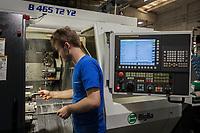 Switzerland. Canton Ticino. Mezzovico. Tecnopinz SA. A worker on a Biglia B465 T2 Y2 turning machine. 17.07.2018 © 2018 Didier Ruef