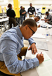 LaMyra Wynn of Florissant begins an assessment test at a Diversity Fair sponsored by the St. Louis County branch of the Ethical Society of Police. The fair was held at Hazelwood Central High School on Saturday August 11, 2018 with police agencies from ten different jurisdictions represented.   Photo by Tim Vizer