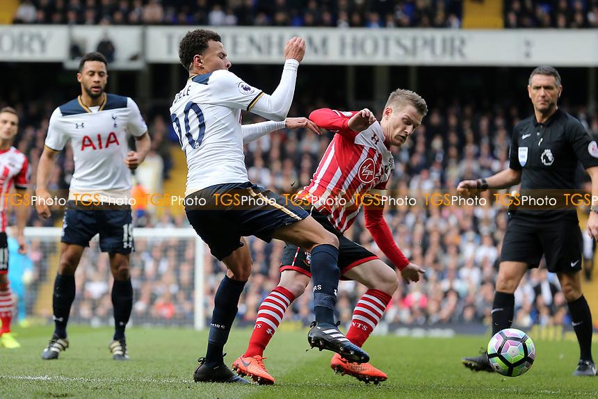 Steven Davis of Southampton upends Dele Alli of Tottenham Hotspur for a penalty during Tottenham Hotspur vs Southampton, Premier League Football at White Hart Lane on 19th March 2017