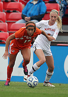COLLEGE PARK, MD - OCTOBER 28, 2012:  Ashley Spivey (8) of the University of Maryland holds onto Kim Hutchinson (17) of Miami during an ACC  women's tournament 1st. round match at Ludwig Field in College Park, MD. on October 28. Maryland won 2-1 on a golden goal in extra time.