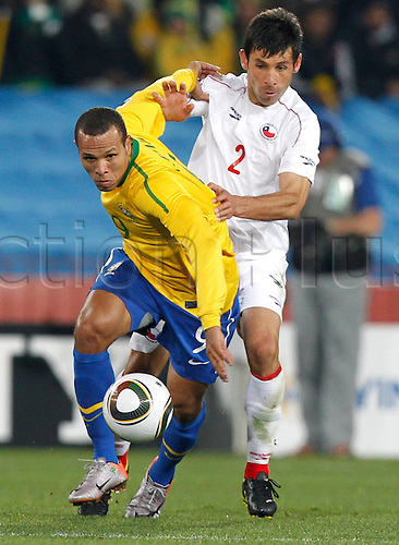 28 06 2010 FIFA World Cup 2010  Country game Brazil vs Chile Picture shows Luis Fabiano BRA and Ismael Fuentes CHI