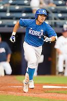 Nam-Seok Kim #6 of Team Korea hustles down the first base line against Team USA at Durham Bulls Athletic Park July 18, 2010, in Durham, North Carolina.  Photo by Brian Westerholt / Four Seam Images