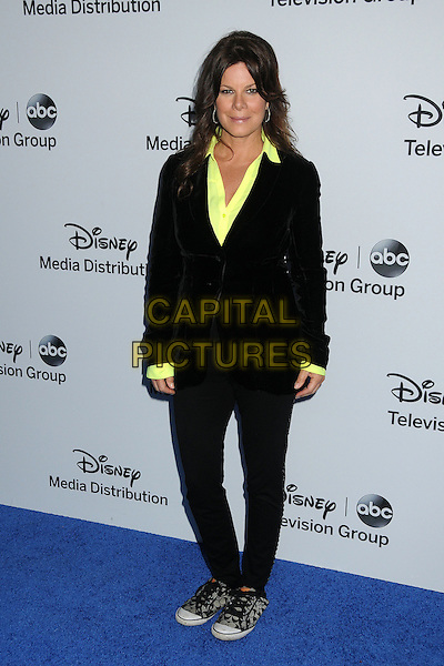 Marcia Gay Harden.Disney Media Networks International Upfronts 2013 held at Walt Disney Studios, Burbank, California, USA..May 19th, 2013.full length black suit yellow shirt sneakers trainers shoes .CAP/ADM/BP.©Byron Purvis/AdMedia/Capital Pictures