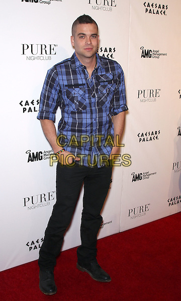 MARK SALLING .Mark Salling hosts an evening at Pure Nightclub inside the Caesar's Palace Casino Resort,  Las Vegas, Nevada, USA, 19th March 2011..full length blue plaid checked shirt hands in pockets  jeans .CAP/ADM/MJT.© MJT/AdMedia/Capital Pictures.